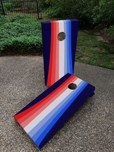Custom regulation cornhole boards in a retro striped pattern in red white and blue. Perfect for your 4th of July barbecue.