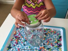 Create a bead drop jar!  A simple, low prep fine motor activity using a canning jar for preschoolers from Modern Preschool.
