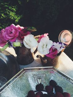 Dinner in the garden. Antiques and eustoma. Vase made from vintage pots. Silver, vintage tray. By Luna and the Table