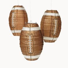 Football Lanterns (3 pc) by Fun Express. $8.50. Paper.. 3 Football Lanterns.. Metal Hangers Included.. Lanterns Measure 6 1/2 Inch Diam.. Prepare your TV room for the big game with these Football Lanterns. These football shaped lanterns are the perfect Superbowl decorations.