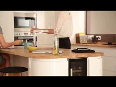 Gloss White Integrated Handle - contemporary kitchen from Howdens Joinery - YouTube
