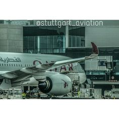 Qatar Airways Airbus A350 loading cargo at the gate at Frankfurt Airport