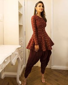 Dhoti Pant Outfit Ideas For The Coolest Bride Ever! is part of Dhoti salwar suits - Dhoti pants are high on trend right now! Here are 6 different outfit ideas to style for dhoti pants with Indian Attire, Indian Wear, Indian Outfits, Indian Designer Outfits, Designer Dresses, Designer Clothing, Peplum Top Outfits, Peplum Tops, Pants Outfit