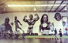 """#TheRock said... """"Bad ass massive gym mural from @howes.dis of me and a few of my iconic buds who've inspired generations over the years. Rock, Jordan, Arnold, Rich Froning and Ronda."""" #JordanDunkinOnMe #BloodSweatAndRespect #FirstTwoYouGive #LastOneYouEarn"""