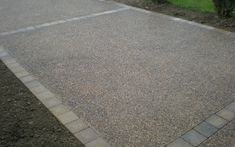 Exposed Aggregates Concrete Driveway with Block Edging.