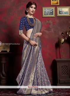 Rich look attire to give your a right choice for any party or function. Be the center of attraction with this navy blue art silk classic saree. This ravishing attire is amazingly embroidered with weaving work. Comes with matching blouse. Navy Blue Saree, Blue Silk Saree, Saree Wearing Styles, Saree Styles, Fancy Blouse Designs, Sari Blouse Designs, Sari Draping Styles, Latest Silk Sarees, Saree Dress