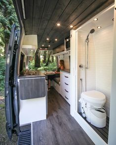 "Sprinter Van Conversion Discover Logan - Freedom Vans ""Logan"" is a clean and stylish van built for two doctors who will be living and working out of it for months at a time. It features a modular work station dinette and full wet bath."
