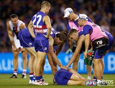 Round 6 - Clay Smith goes down with a knee injury Clay Smith, Australian Football League, Western Bulldogs, Rugby Players, Knee Injury, Great Team, In This Moment, Seasons, Running