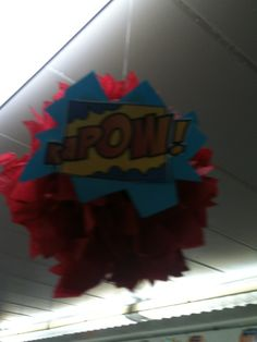 Hanging Pom Pom's with Onomatopoeia on them for my Super Hero Themed classroom.