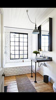 Vintage-like bathroom; black-rimmed windows. Cute