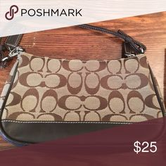 """Authentic Coach signature Demi bag Authentic Coach signature Demi bag. Fabric upper, leather bottom, trim, and straps. One main compartment, one pouch pocket. Top zipper closure. Strap drop is 6-3/4"""". Some signs of wear as shown in last picture. Coach Bags Mini Bags"""