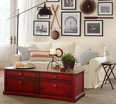 Fillmore Sectional Floor Lamp   Pottery Barn. I love how the rustic red coffee table perfect accents a room full of neutrals.