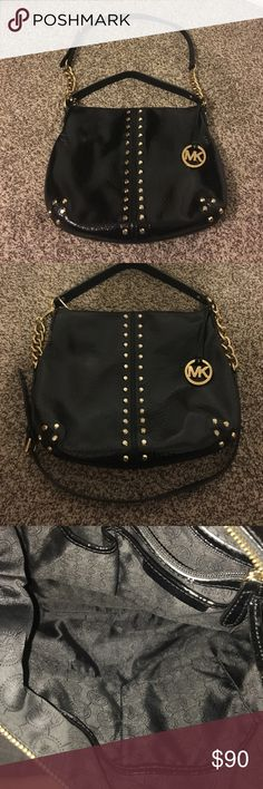 Michael Kors Crossbody/Shoulder Bag Black Michael Kors Crossbody/Shoulder Bag with gold studs. One of my favorite putse since it holds a lot of items and can use either cross or shoulder bag  See picture 4 for minor wear - not visible. Michael Kors Bags