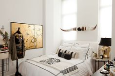 LOVE the gold, white & global mix in the bedroom of Kelly from The Glamouri