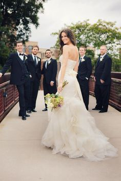 great way to show off the dress and the groomsmen