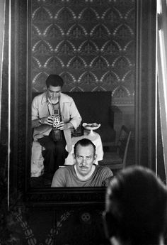 John Steinbeck in Moscow, 1947, photographed in his hotel room mirror by Robert Capa