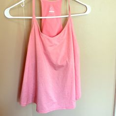 Dri Fit Nike tank Adorable slightly flared tank with built in bra. Splits on sides to make extra light and airy. Coral colored Nike Tops Tank Tops