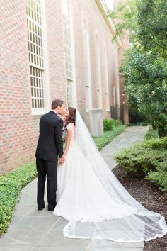 A Classic Black Tie Country Club of Virginia Wedding in Richmond Virginia. Cathedral Veil. Beautiful Outdoor wedding portraits.