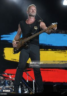 Photo of POLICE and STING; Sting performing live onstage at MCG