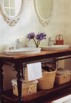 the towel bar on this open vanity is perfect & the different wood tones look beautiful together