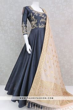 Palkhi fashion exclusive prussian blue raw silk outfit with elegant kundan,gota,white pearl and handcrafted petite stone work on top and sleeve.This outfit comes with gorgeous contrast beige colored soft pure silk duppata