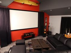 A+professionally+installed+100-inch+screen+with+retractable+theater+curtains+and+HD+projector+is+much+more+conducive+to+an+at-home+cinema+experience.