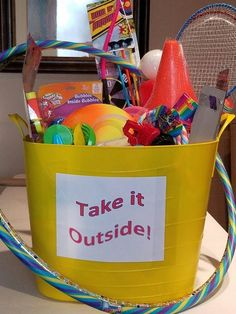 Take it Outside. Basket for silent auction filled with toys and items kids can take outside.