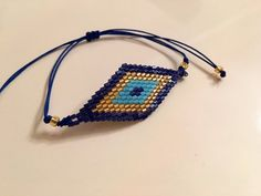 Beautiful Creation! This bracelet is woven in peyote using Japanese miyuki delica seed beads in blue,deep blue , cream. No clasp in this…