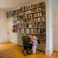Wall-mounted shelves find their way around a radiator and door. Shelf depths of 8½ and 11 accommodate the library