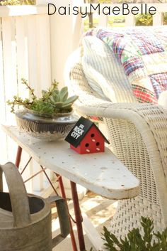 Vintage Ironing Board as side table on porch @ DaisyMaeBelle