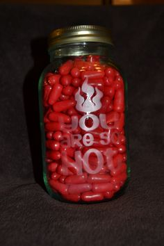 """Glass mason jar etched with """"You are so HOT"""" and filled with Hot Tamales for Valentine's present.  Bedtime Vinyl Creations."""
