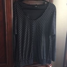 Black and silver v-neck top with banded waist This is a Black and silver v-neck top with banded waist. It is great for work or weekends! a.n.a Tops