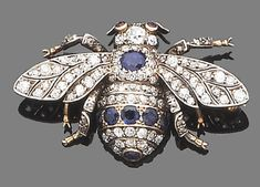 A late 19th century sapphire, ruby and diamond bee brooch, circa 1880  The body set with single-cut diamonds and circular-cut sapphires, the head and wings set throughout with single and old brilliant-cut diamonds, with circular-cut ruby eyes, mounted in silver and gold, diamonds approx. 2.10ct. total, width 4.5cm.