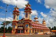 This colorful building is the Cao Dai temple in Vietnam.  It's located in South Vietnam just outside Ho Chi Minh City (Saigon).  Caodaism is a very young religion, it started in 1926.  This religion combines the teachings of Buddhism, Hinduism, Taoism,  Viettel IDC Colocation Dedicated Server Hosting VPS Domain  http://viettelidc.com.vn
