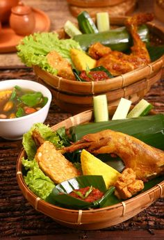 NASI TIMBEL - Javanese daily lunch menu   banana leave steamed rice, fried chicken, fried tempeh, fried tofu, fresh cucumber and chilli paste.