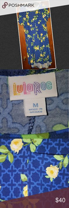 LulaRoe Carly (Md) NWOT LulaRoe Carly (Md) NWOT - Colors are Dark-n-light blue, yellow, dark-n-light green - Decided I didn't like it after buying it 😟 - Never been worn (no tag) - Just wanting part of money back - Feel free to ask me any questions LuLaRoe Dresses