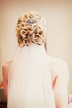 Beautiful wedding updo. Photo by Kelly T. #BridalHair I like this, you get the updo the sparkle and the veil all in one.