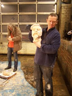 Alistair (in the foreground) with his portrait of Don, Alex (in the background) carefully removing the final layer of plaster waste mould from his portrait.
