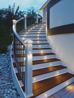 Contrasting paint colors and mini lights built into the stair's steps, posts, and post caps work in tandem to make it easy to ascend to this deck at night. If your deck sits in a sunny spot, consider installing solar-powered lights for an energy-savings option.