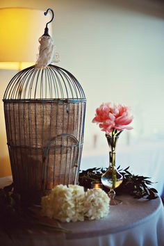 Gift Bird Cage~  Read more - http://www.stylemepretty.com/2013/08/07/atlanta-wedding-from-arina-borodina-photography/
