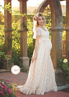 The Josephine Flutter Sleeve Maternity Gown is a timeless addition to any maternity wardrobe! This gown, with a delicate sheer lace on the shoulder top and a stunning ruffled lace skirt, is sure to be