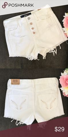 "High rise distressed shorts size 0 Brand new with tags. Hollister brand. Super cute bottoms detail and high waisted fit with distressing. Your perfect white summer shorts. Back pocket arrow embroidered details. Size 0 fits 24"" Hollister Shorts Jean Shorts"