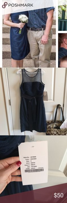 Navy Illusion Neckline Dress Navy dress with illusion neckline. Brand new with tags. Never worn, the picture is of one of my bridesmaids wearing hers. We ordered one extra and then couldn't return the extra like we thought we could. Matching navy ribbon can be tied in the back or in the front. Side zipper and hook and eye. Skirt hits at the knee. Fits like a true size 8. Bust has ribbing and plenty of padding so you don't have to wear a bra if you don't want to. This would be great for a…