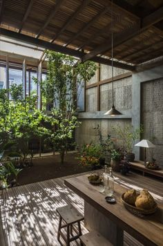 Rotating metal panels shelter open-air home in Vietnam - Curbedclockmenumore-arrownoyes The metal shutters can be opened to let in ample light and air transforming the space into a greenery-filled pavilion Modern Tropical House, Tropical House Design, Tropical Interior, Interior Garden, Tropical Houses, Interior And Exterior, House Exterior Design, Interior Design, Tropical Architecture