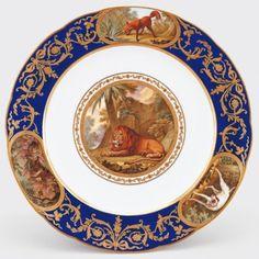 Assiette unie. Sèvres Porcelain Factory 1758. Soft-paste porcelain. Beau bleu grounds, and gilded decoration. Green Drawing Room, Windsor Castle  The Royal Collection Trust