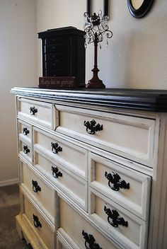 We recently painted an old dresser and put new hardware on it and it looks better than new so now I'm inspired to redo our bedroom furniture - going to pin some ideas.  I like this color -  spray painted dresser - krylon ivory and krylon black, handles are oil rubbed bronze