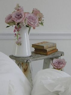 white pitcher, flowers, rustic ladder used as a sidetable