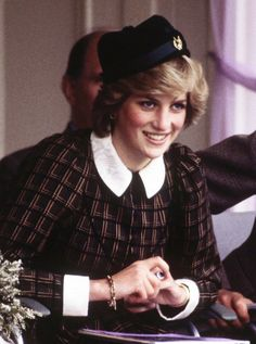 Head of the Class  Diana sported a printed shirtdress and pinned side cap while watching the 1982 Braemar Games in Scotland.