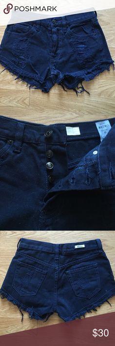 Brandy Melville Distressed Denim Shorts Brandy Melville Distressed Denim Shorts with front button closure. NWOT Brandy Melville Shorts Jean Shorts