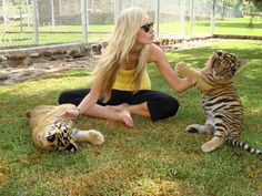 Andrina Kaupert playing with some baby tigers! | Bloemfontein, South Africa #travel #babyanimals #adorable